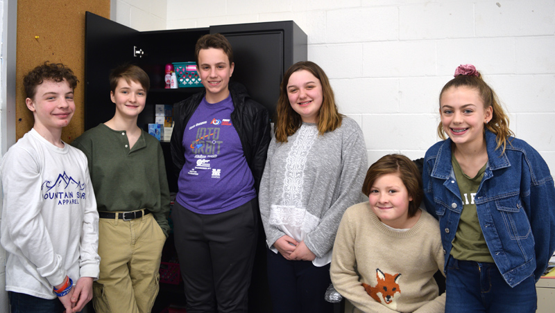 "Members of the Great Salt Bay Community School Student Council stand around the ""comfort closet,"" their effort to provide hygiene items and snacks to students in need. From left: Joseph Krawic, Ava Nery, Connor Parson, Olivia Swartzentruber, Lydia Branson, and Mariana Janik. Members absent from the photo are Aiden Jacobs, Liam Card, Michaela LaCrosse, and Aleshia Alicea. (Jessica Clifford photo)"