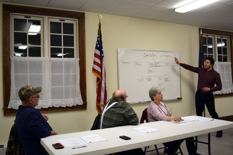 From left: Third Selectman Allan Moeller, Second Selectman Dwight Keene, and First Selectman Trudy Foss listen as Administrative Assistant Michael Henderson explains the current structure of the town office during a public hearing at Pownalborough Hall on Monday, Feb. 25. (Jessica Clifford photo)