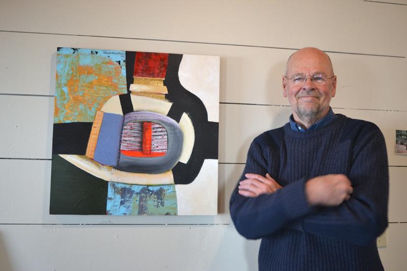 "Jaap Eduard Helder poses with one of his recent paintings, ""Mystic Sentinel."" (Christine LaPado-Breglia photo)"