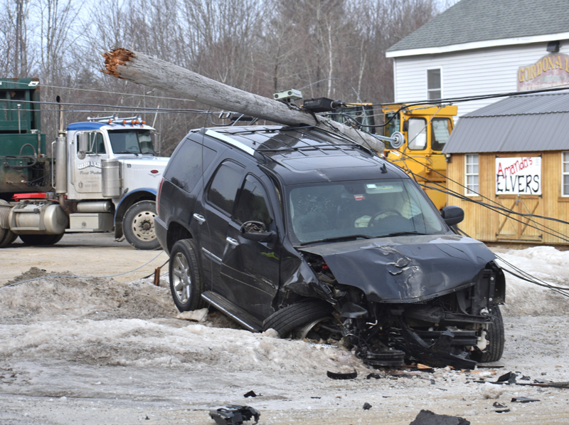 A utility pole rests atop a GMC Yukon Denali SUV after a two-vehicle collision on Route 1 in Waldoboro the morning of Tuesday, Feb. 12. There were no injuries in the crash, according to police. (Alexander Violo photo)