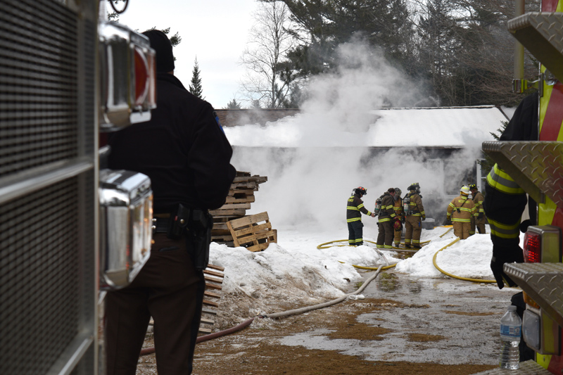 Firefighters work at the scene of a house fire at 48 Greenleaf Road on Westport Island. (Jessica Clifford photo)