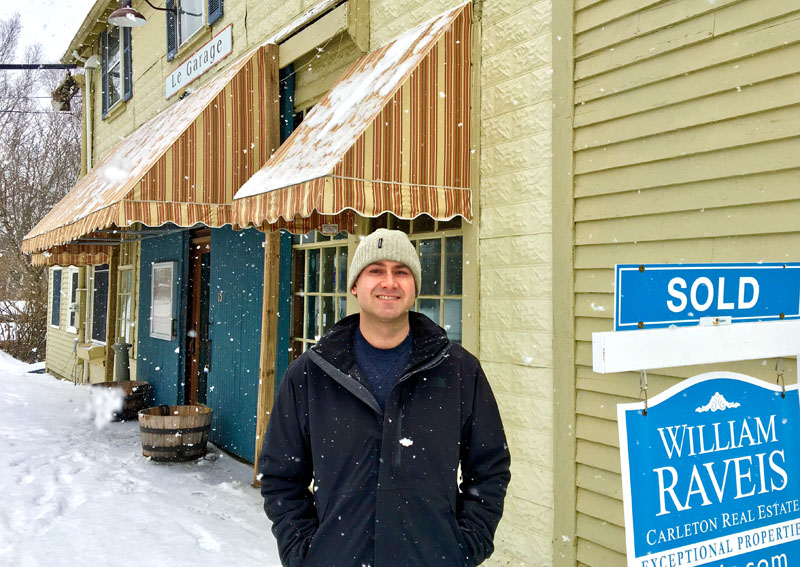 Ed Colburn stands in front of his new restaurant, the former Le Garage, at 15 Water St. in Wiscasset. He plans to reopen the restaurant in the spring. (Suzi Thayer photo)
