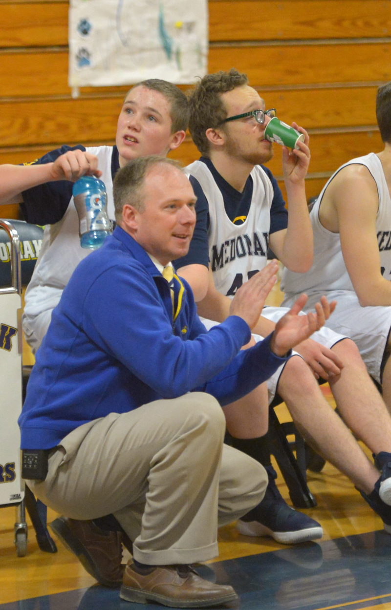 Medomak Unified coach Paul Smeltzer cheers on his team at home on Feb. 12. (Paula Roberts photo)