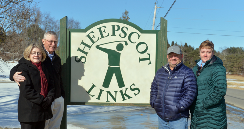 Mary Ann and George Hall (left) sold Sheepscot Links to Leon and Alicia Oliver on Thursday, Feb. 7. (Paula Roberts photo)