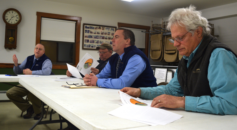 Lincoln County Sheriff Todd Brackett (far left) speaks during a public hearing at the Alna fire station Tuesday, March 12 as, from left, Alna Fire Chief Michael Trask, Lincoln County Sheriff's Office Chief Deputy Rand Maker, and Alna resident Chris Kenoyer listen. (Jessica Clifford photo)