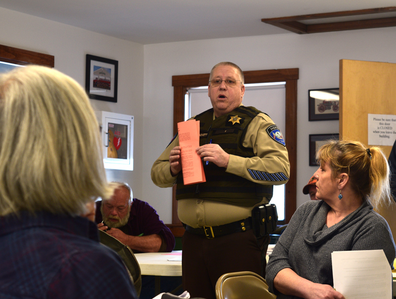Lincoln County Sheriff Todd Brackett talks to Alna voters about the purpose of a false alarm ordinance during annual town meeting at the fire station Saturday, March 23. Voters approved the ordinance. (Jessica Clifford photo)