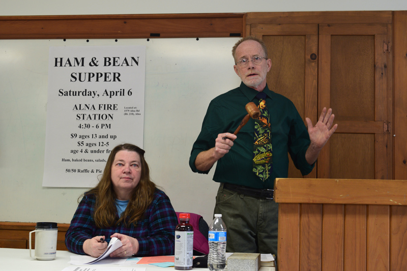 Moderator Chris Cooper keeps order while Town Clerk Liz Brown looks on during Alna's annual town meeting Saturday, March 23. (Jessica Clifford photo)