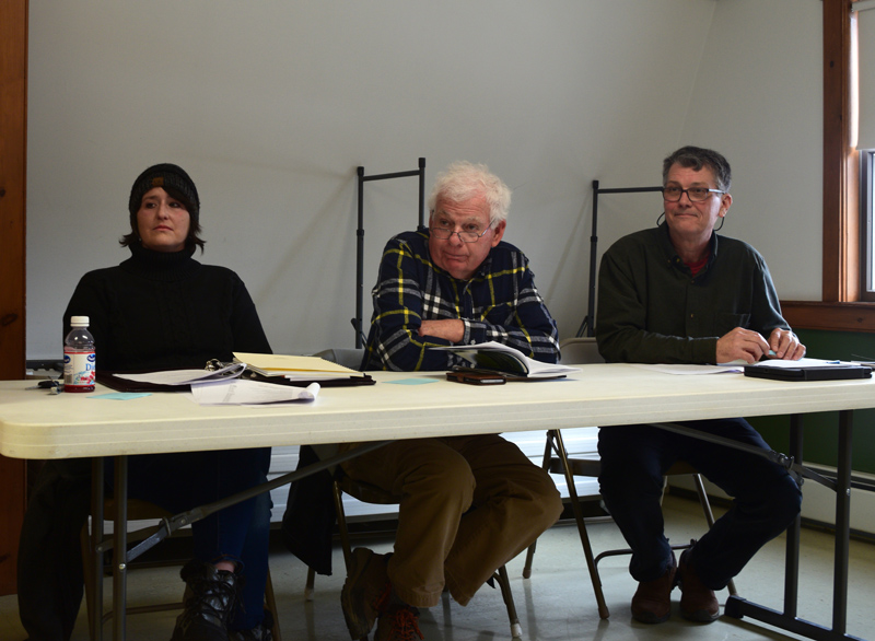 From left: Alna First Selectman Melissa Spinney, Third Selectman Doug Baston, and Second Selectman Ed Pentaleri listen to a resident's comments at annual town meeting Saturday, March 23. (Jessica Clifford photo)