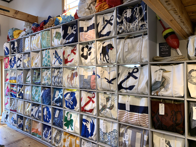 A wall of tote bags at a Sea Bags shop in Rehoboth Beach, Del. All Sea Bags shops have similar displays. (Photo courtesy Sea Bags)