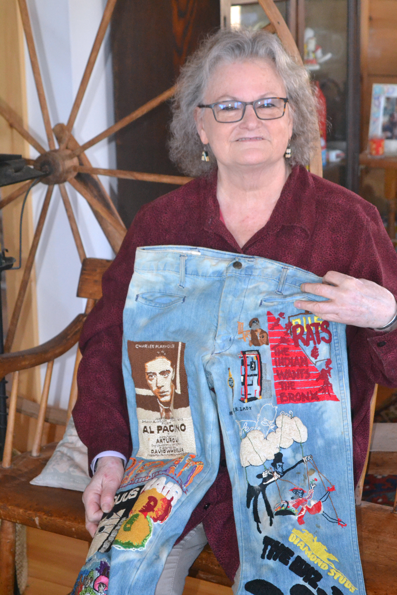 Beth Farrell, of New Harbor, who was the late Hollywood composer John Morris' neighbor for many years, holds a pair of embroidered blue jeans, created at the request of filmmaker Mel Brooks. (Christine LaPado-Breglia photo)