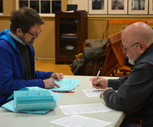 Alden Sproul (left) and Kenneth Frederic count ballots cast in the Bristol election the evening of Monday, March 18. (Maia Zewert photo)