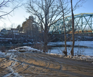Dresden voters will decide whether to accept a gift from the estate of Inge Foster, a former selectman, to restore the Eastern River town landing under the Route 197 bridge. Foster lived in the house across the river. (Alexander Violo photo)