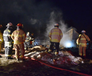 Area firefighters on scene of a barn fire in Jefferson on the night of Sunday, March 17. Farm animals died as a result of the blaze. (Jessica Clifford photo)
