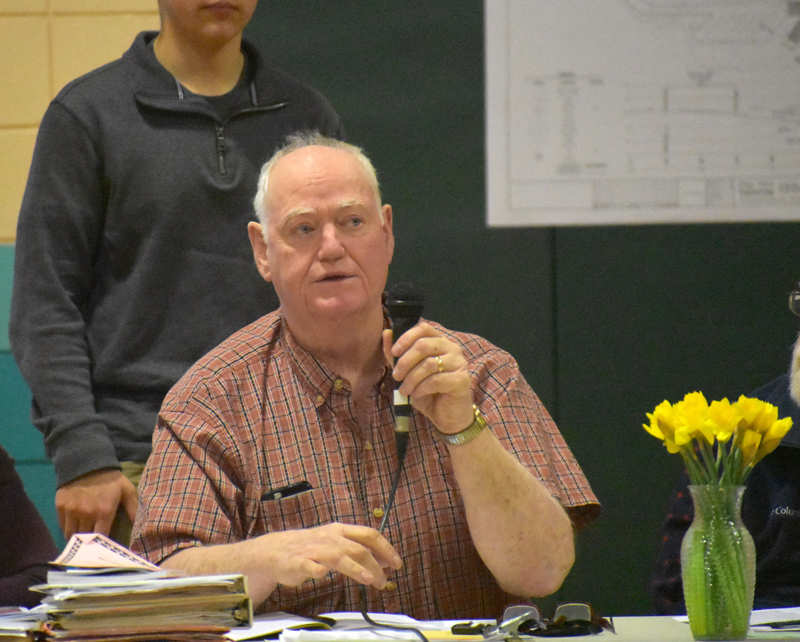Nobleboro Board of Selectmen Chair Dick Spear talks about increases in the town budget during town meeting at Nobleboro Central School on Saturday, March 16. (Alexander Violo photo)
