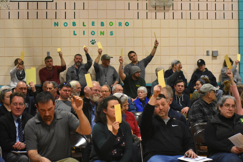 Nobleboro residents vote on an article during town meeting in the Nobleboro Central School gym the morning of Saturday, March 16. (Alexander Violo photo)