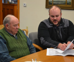 Maine Department of Transportation Project Manager Jason Stetson (right) speaks with South Bristol Harbor Master Cecil Burnham during the South Bristol Board of Selectmen's meeting Thursday, March 14. (Maia Zewert photo)