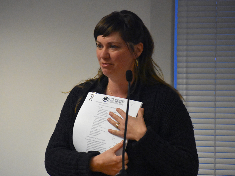 Sarah McNeil, of Odd Alewives Farm Brewery, presents the brewery's plans to add a small commercial kitchen with a pizza oven to the Waldoboro Planning Board. (Alexander Violo photo)