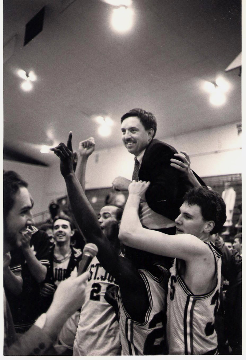 Rick Simonds' players lift him onto their shoulders after a 75-74 win over Castleton State College to take the National Association of Intercollegiate Athletics' 1986-1987 New England championship and secure a berth in the national tournament. (Photo courtesy St. Joseph's College Athletics)