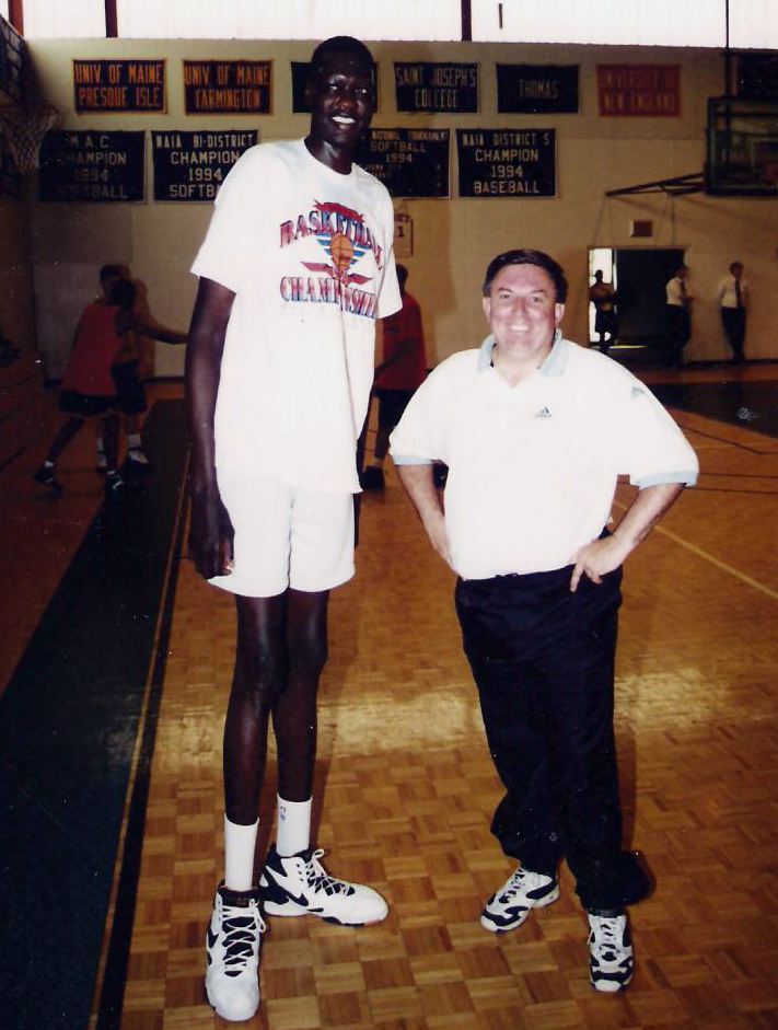 Rick Simonds (right) with Manute Bol at St. Joseph's College in 1996, when Simonds was the assistant coach of the Portland Mountain Cats in the U.S. Basketball League. A The 7-foot-7-inch former NBA blocks leader spent the preseason with the Mountain Cats, who would often practice at St. Joseph's. (Photo courtesy St. Joseph's College Athletics)