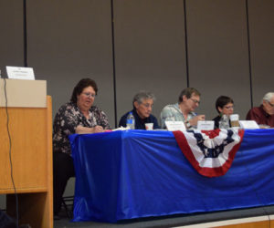 From left: Moderator Jeffrey Frankel concludes Whitefield's annual town meeting as Administrative Assistant Darlene Beaulieu and Selectmen Tony Marple, Lester Sheaffer, Charlene Donahue, Bill McKeen, and Frank Ober look on. (Jessica Clifford photo)