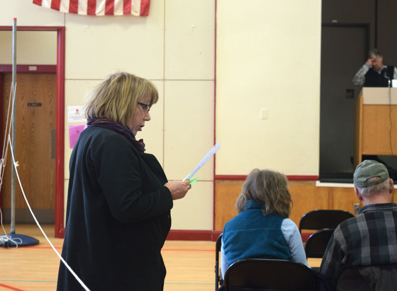 Whitefield resident Robin Chase reads a statement in opposition to a local food sovereignty ordinance at town meeting, Saturday, March 16. (Jessica Clifford photo)