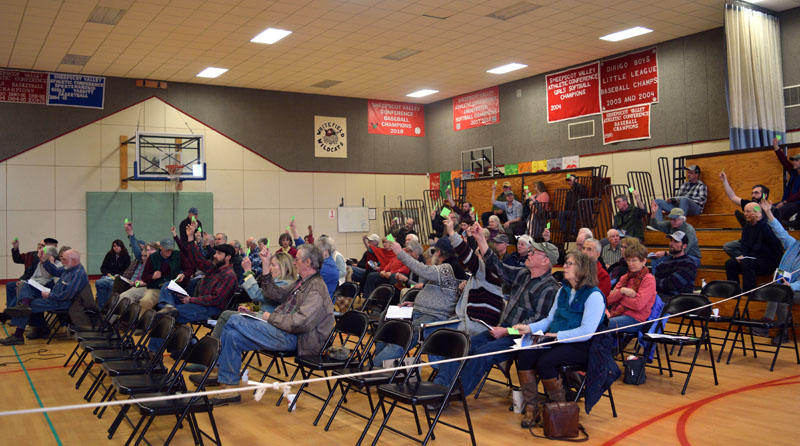 After much debate, a majority of Whitefield residents vote in support of a local food sovereignty ordinance during annual town meeting in the Whitefield Elementary School gym Saturday, March 16. (Jessica Clifford photo)