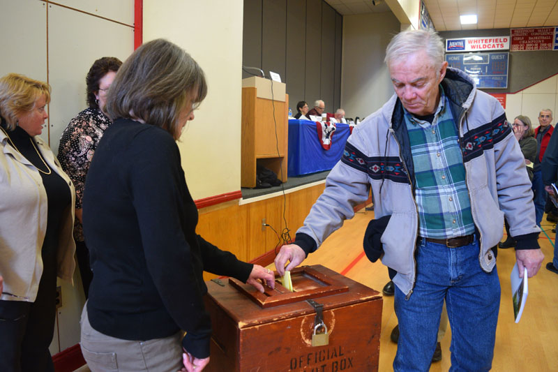 Whitefield resident Mike McMorrow places his ballot in the box during annual town meeting, Saturday, March 16. (Jessica Clifford photo)