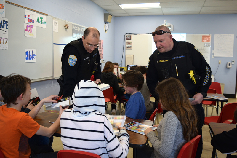 From left: Wiscasset School Resource Officer Cory Hubert and Wiscasset Police Chief Larry Hesseltine hand out name tags to fifth-graders during the first day of a D.A.R.E. class at Wiscasset Elementary School on Thursday, Feb. 28. (Jessica Clifford photo)