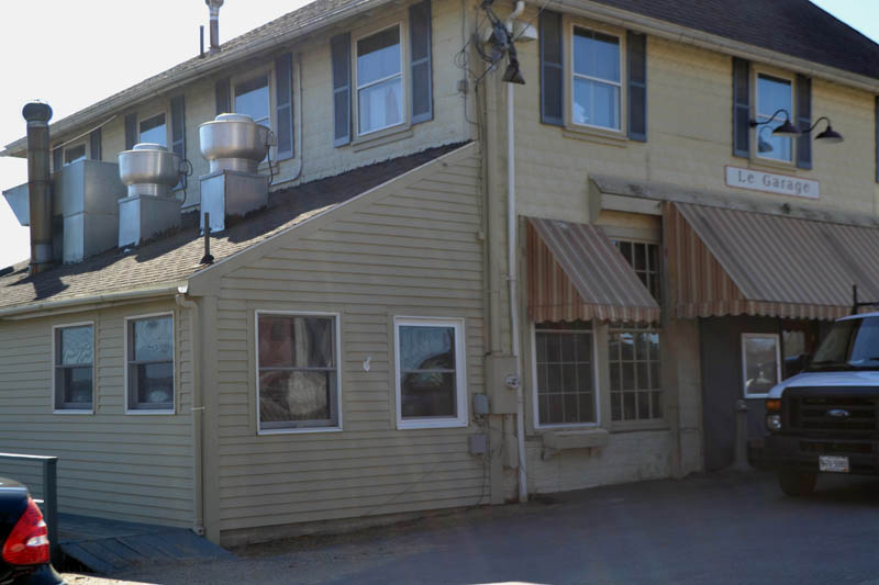 An architect for the new owner of the former Le Garage aims to conceal condensing units on the lower roof of the building's Main Street side. The Wiscasset Historic Preservation Commission is reviewing an application for these and other changes to the building's exterior. (Charlotte Boynton photo)