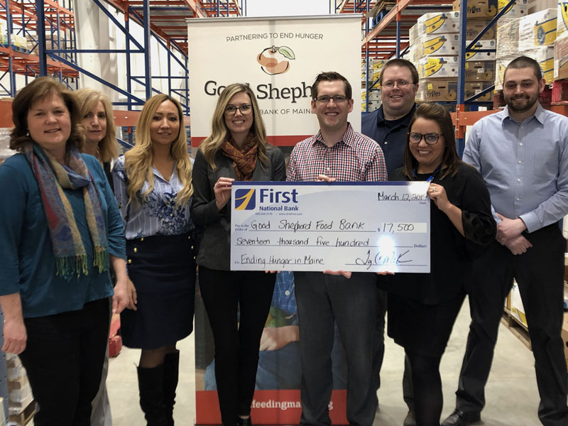First National Bank presents Good Shepherd Food Bank with a check for $17,500.