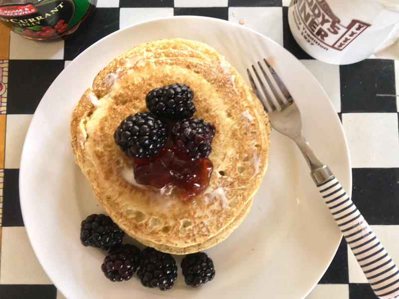 Ployes slathered with butter, a little jam, and some blackberries, with a cup of coffee, make for an awesome breakfast. (Suzi Thayer photo)