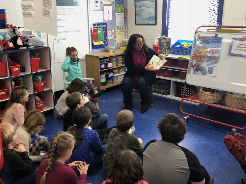 Larissa Darcy, of Bar Harbor Bank & Trust, shares a story with students in Wiscasset.