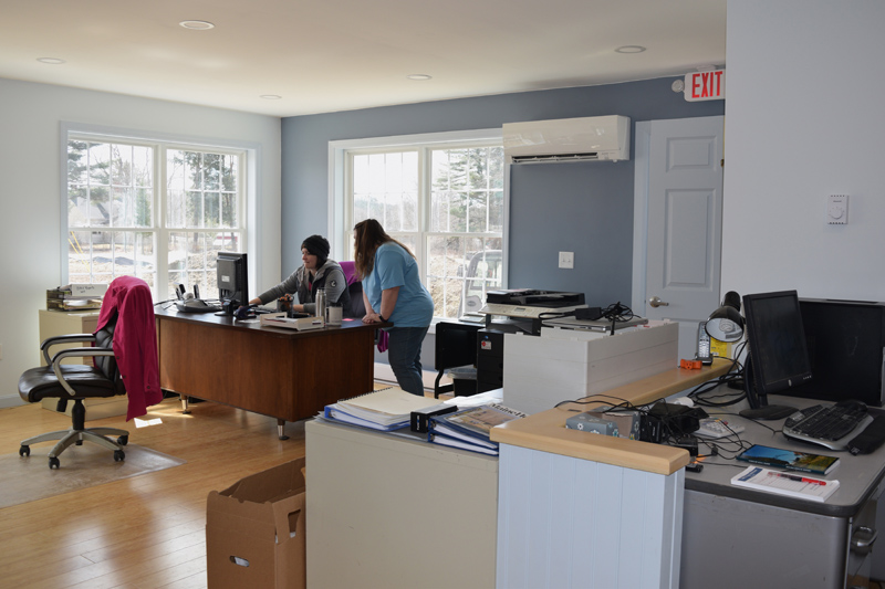 Alna First Selectman Melissa Spinney and Town Clerk Liz Brown work in the new town office. (Jessica Clifford photo)