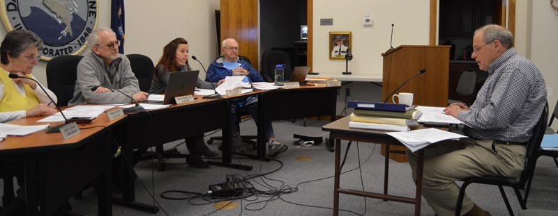 Damariscotta Town Manager Matt Lutkus (right) discusses changes to draft marijuana ordinances with the board of selectmen, at table from left: Chair Robin Mayer and Selectmen Ronn Orenstein, Amy Leshure, and Louis Abbotoni. (Evan Houk photo)