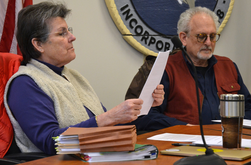 Damariscotta Board of Selectmen Chair Robin Mayer reads from her notes on marijuana ordinances as Selectman Ronn Orenstein looks on during a workshop at the town office Wednesday, March 27. (Maia Zewert photo)