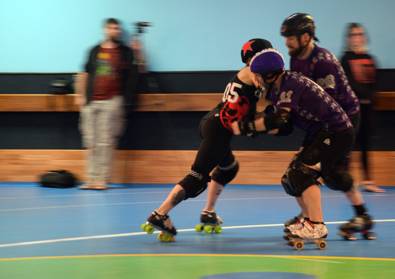 A Casco Bay Roller Derby player blocks a Flour City Fear player. (Jessica Clifford photo)
