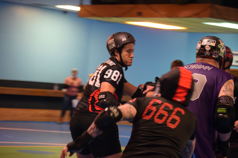Michael Henderson (left) blocks during a game against the Flour City Fear, of Rochester, N.Y., at Happy Wheels Skate Center in Portland on April 6. Henderson is usually a jammer, but played both jammer and blocker April 6. (Jessica Clifford photo)