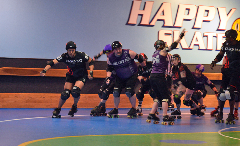 Casco Bay Roller Derby jammer Michael Henderson (left) becomes lead jammer in a game against the Flour City Fear. (Jessica Clifford photo)