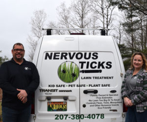 Eric and Heather Brewer, of Edgecomb, stand alongside the van for their new business, Nervous Ticks. The business offers organic lawn treatment to control ticks and other pests. (Jessica Clifford photo)
