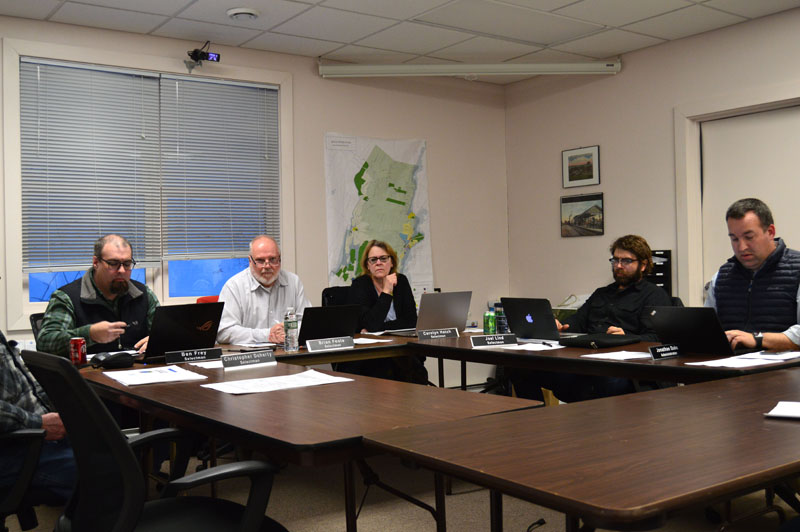 The Newcastle Board of Selectmen meets at the town office Monday, April 8. From left: Selectmen Ben Frey, Brian Foote, Carolyn Hatch, and Joel Lind, and Town Administrator Jonathan Duke. (Evan Houk photo)