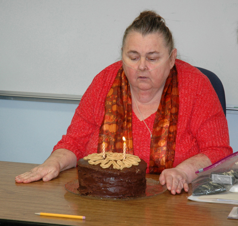 Somerville Third Selectman Darlene Landry blows out the candles on her birthday cake at the end of a selectmen's meeting Nov. 1, 2017. Landry resigned from the board effective April 1. (Alexander Violo photo, LCN file)