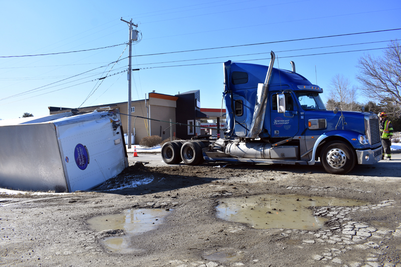 There were no injuries when the trailer of a tractor-trailer detached and rolled onto its side on Winslows Mills Road in Waldoboro, near Route 1, the morning of Thursday, April 11. (Alexander Violo photo)