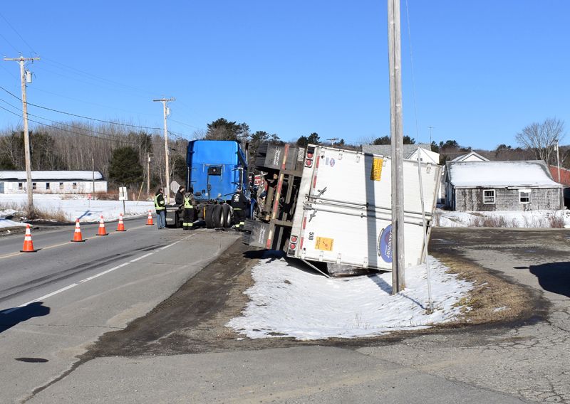 The trailer of a tractor-trailer lies on its side in a ditch on Route 32 in Waldoboro the morning of Thursday, April 11. A mechanical issue caused the trailer to detach, according to police. (Alexander Violo photo)