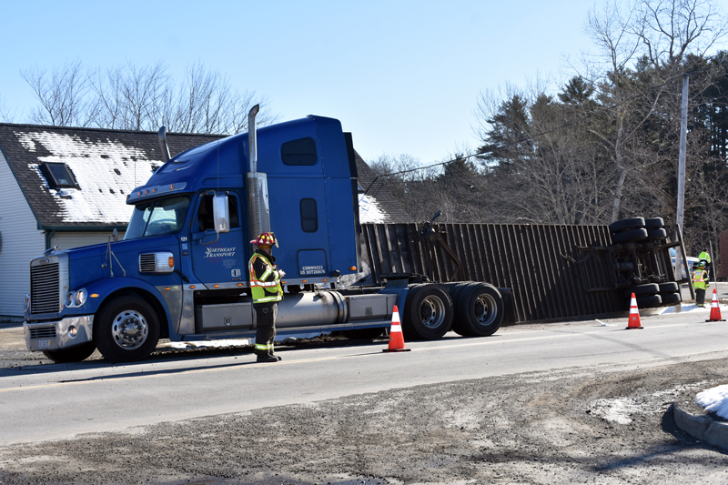 Waldoboro firefighters work at the scene of a tractor-trailer accident on Route 32 the morning of Thursday, April 11. (Alexander Violo photo)