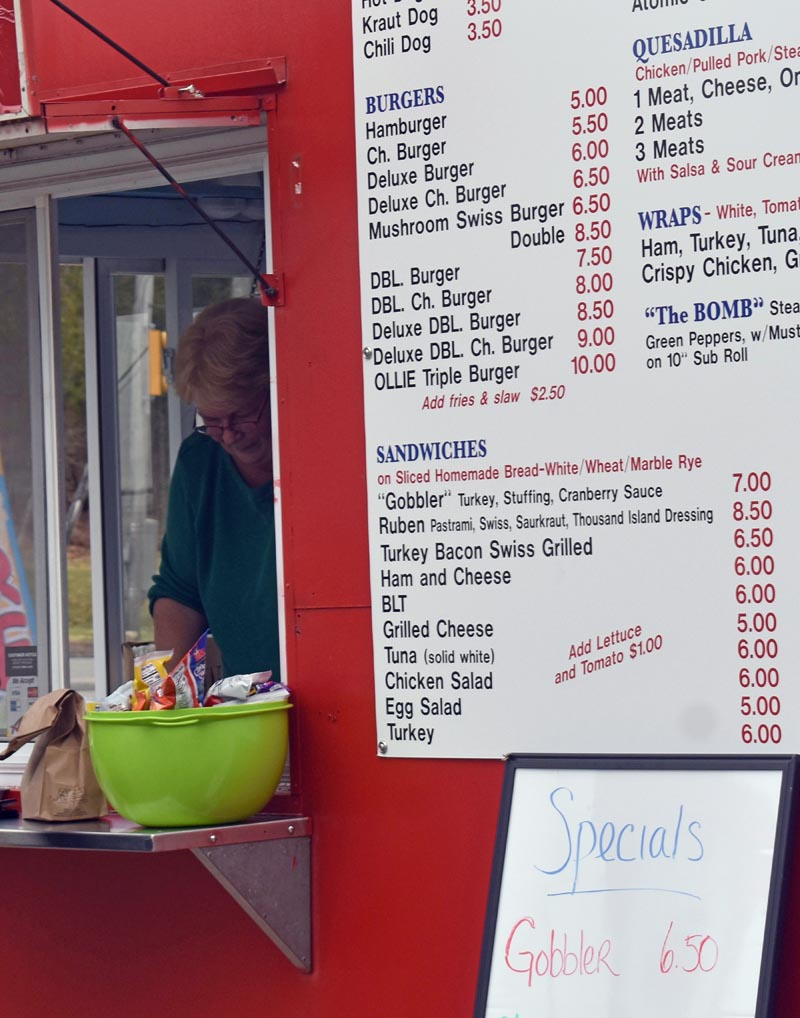 Ollie's owner Vickey Jones fills a lunch order during opening day at Ollie's takeout stand in Waldoboro on Monday, April 22. (Alexander Violo photo)