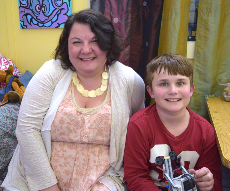 Rachel Hamlin, gifted-and-talented teacher at the Wiscasset School Department, with one of her students, Camden Larrabee. Camden designed and crafted a pedal extension for Hamlin's daughter's wheelchair. (Jessica Clifford photo)