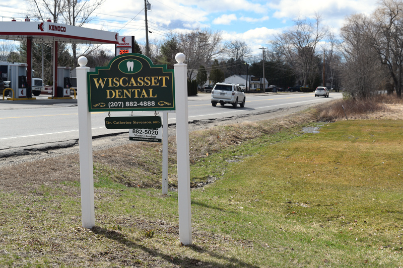 The Wiscasset Dental sign alongside Route 27 in Wiscasset. Lincoln County Dental Inc. has purchased the former Wiscasset Dental building, where it will open a low-income clinic. (Jessica Clifford photo)