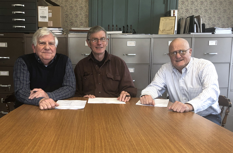 From left: Dick McLean, treasurer of Lincoln County Dental Inc.; Les Fossel, board member; and Dr. Jim Olson, president, attend the closing on the nonprofit's future clinic at attorney Rob Gregory's office in Damariscotta on Monday, April 15. (Photo courtesy Holly Stover)