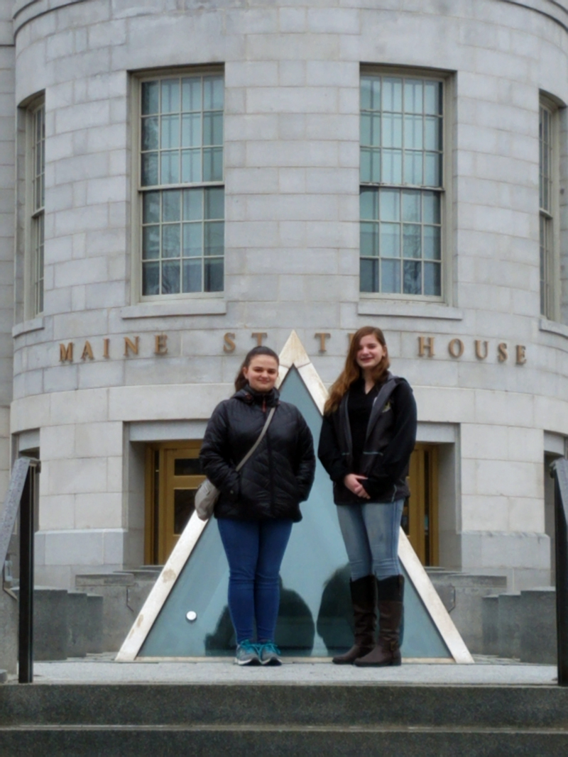 Wiscasset eighth-graders Carolyn Potter and Madison Westrich at the Maine State House.