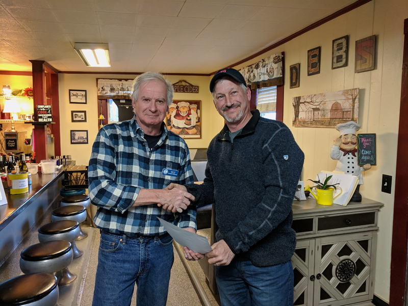 Bristol Area Lions Club President Brendan Donegan (left) presents a 10-year service chevron to Lion Chris Leeman. (Photo courtesy Tom Rodrigues)